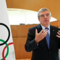 IOC President Thomas Bach speaks to the media on March 25 in Lausanne, Switzerland. | REUTERS
