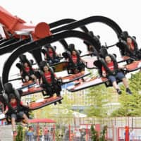Visitors board Legoland Japan theme park's new attraction, Flying Ninjago, at the Lego Ninjago World in Nagoya on July 1, 2019. | KYODO