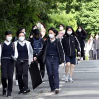 A new data sharing system in South Korea patches together cellphone location data and credit card records to improve contact tracing amid the coronavirus pandemic.    YONHAP / VIA REUTERS
