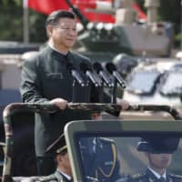 Chinese President Xi Jinping has vowed that by 2049, China would 'become a global leader in terms of composite national strength and international influence.'   BLOOMBERG