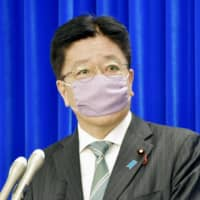 Health minister Katsunobu Kato attends a news conference at the ministry Friday. | KYODO