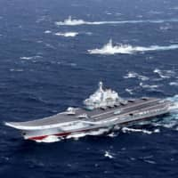 A Chinese Navy flotilla including the aircraft carrier Liaoning conducts exercises in the South China Sea. China claims most of the South China Sea and has militarized a number of artificial islands there. | REUTERS