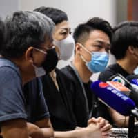 Pro-democracy activists and lawmakers hold a news conference in a meeting room of the Legislative Council in Hong Kong on Friday.  | AFP-JIJI