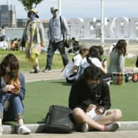 Meriken Park in Kobe on Thursday, the day the government lifted the state of emergency in three prefectures in the Kansai region, including Hyogo | KYODO