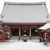 Fewer people than usual are seen at Tokyo's Senso-ji Temple on Thursday, as a coronavirus state of emergency remained in place in the capital.  | KYODO