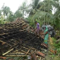 Cyclone leaves trail of devastation along coast of east India and Bangladesh