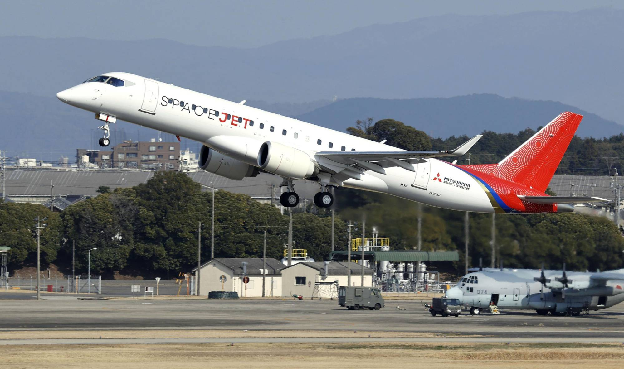 The prototype Mitsubishi SpaceJet takes flight. Mitsubishi Heavy Industries Ltd. is planning to slash the workforce in its struggling regional jet business. | KYODO