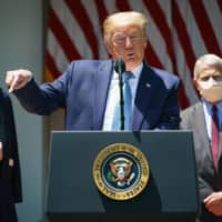 U.S. President Donald Trump speaks on vaccine development, in the Rose Garden of the White House in Washington on May 15. Flanking Trump are White House Coronavirus Task Force members Deborah Birx and Anthony Fauci, director of the National Institute of Allergy and Infectious Diseases. | AFP-JIJI