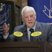 Chris Patten, Hong Kong's last British governor, listens to questions at The Foreign Correspondents' Club to promote his book in the city in September 2017. | AP