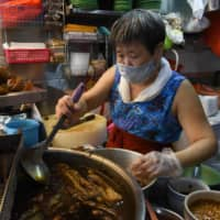 Despite producing little of its own, Singaporeans arguably have better access than anyone else to affordable, abundant and high quality produce. | AFP-JIJI