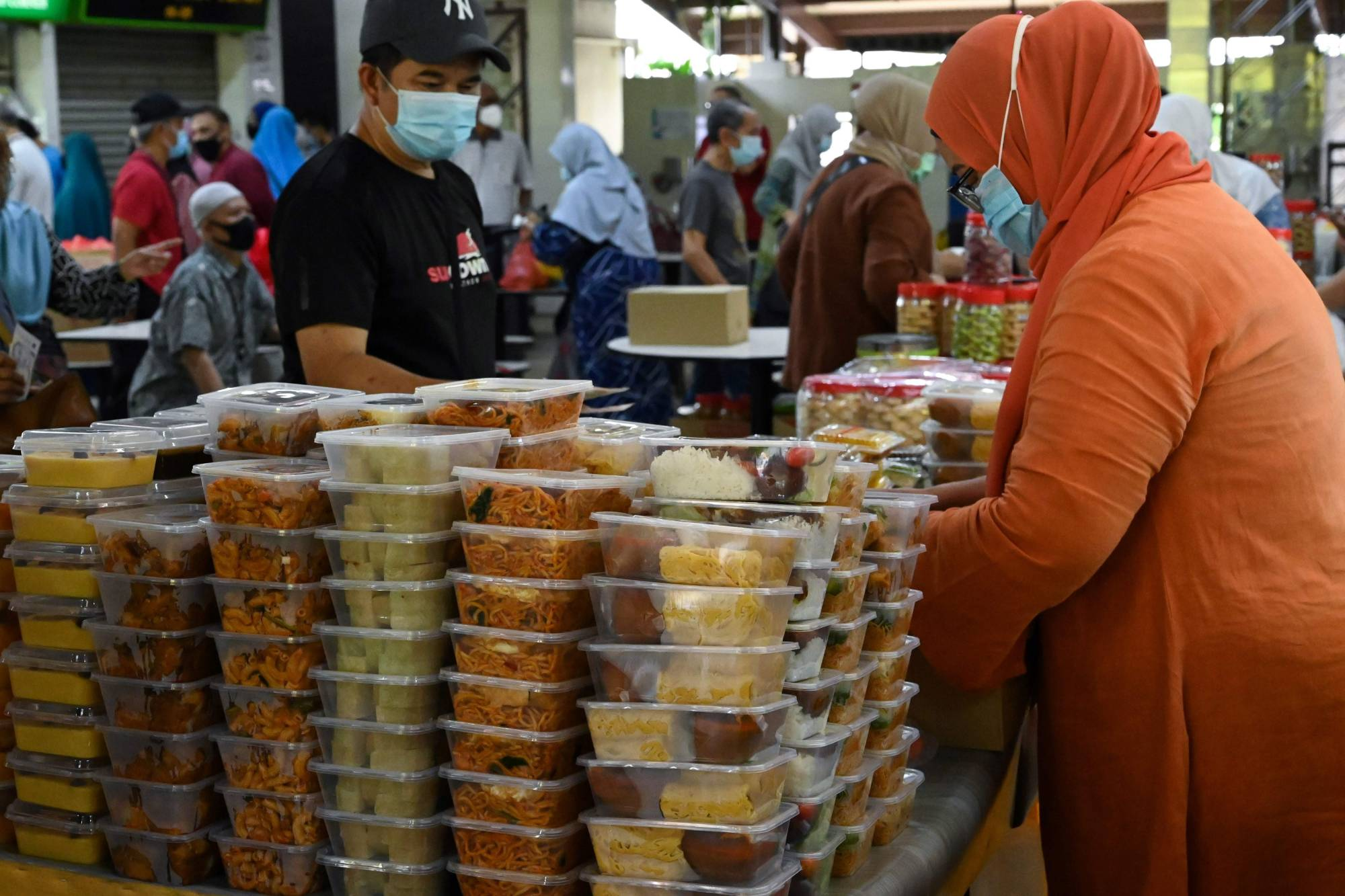 Years of contingency planning — and recent moves to maintain the key flow of goods from neighboring Malaysia — have helped keep supplies arriving in Singapore through pandemic-related disruptions, even as the city-state experienced waves of panic-buying that emptied some supermarket shelves of food. | AFP-JIJI