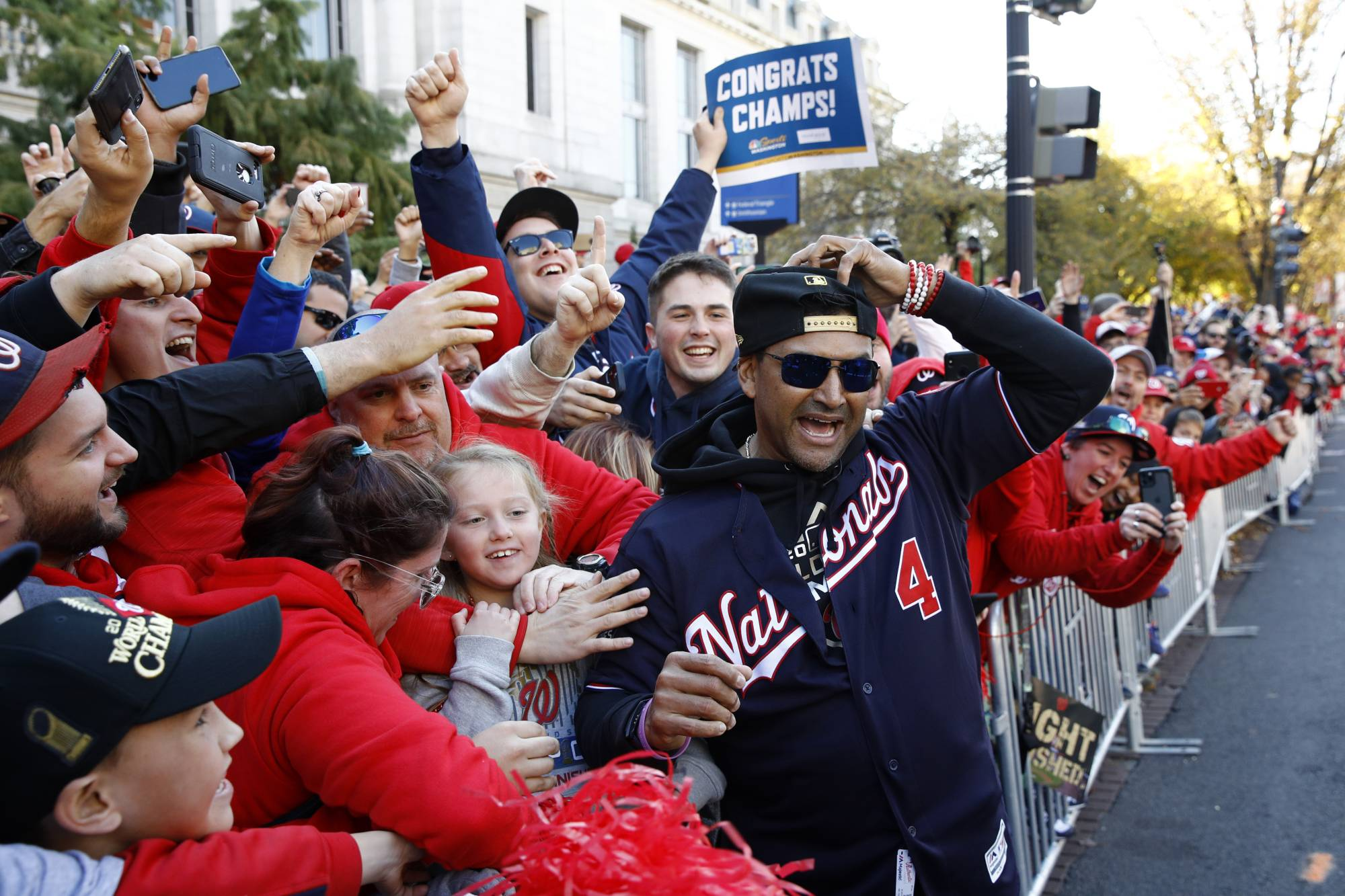 Nationals manager Dave Martinez celebrates with fans during the team's World Series celebration parade on Nov. 2 in Washington. | AP