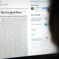 A tweet by the New York Times account shows the early edition front page for Sunday, with a list of 1,000 names that represents 1 percent of the lives lost due to the novel coronavirus pandemic in the U.S.  | AFP-JIJI