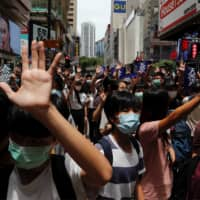 Anti-government protesters march on Sunday again Beijing's plans to impose national security legislation in Hong Kong. | REUTERS
