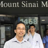 Dr. Takahiro Yanagisawa is seen outside Mount Sinai School of Medicine in New York in a photo taken in September 2012. | KYODO