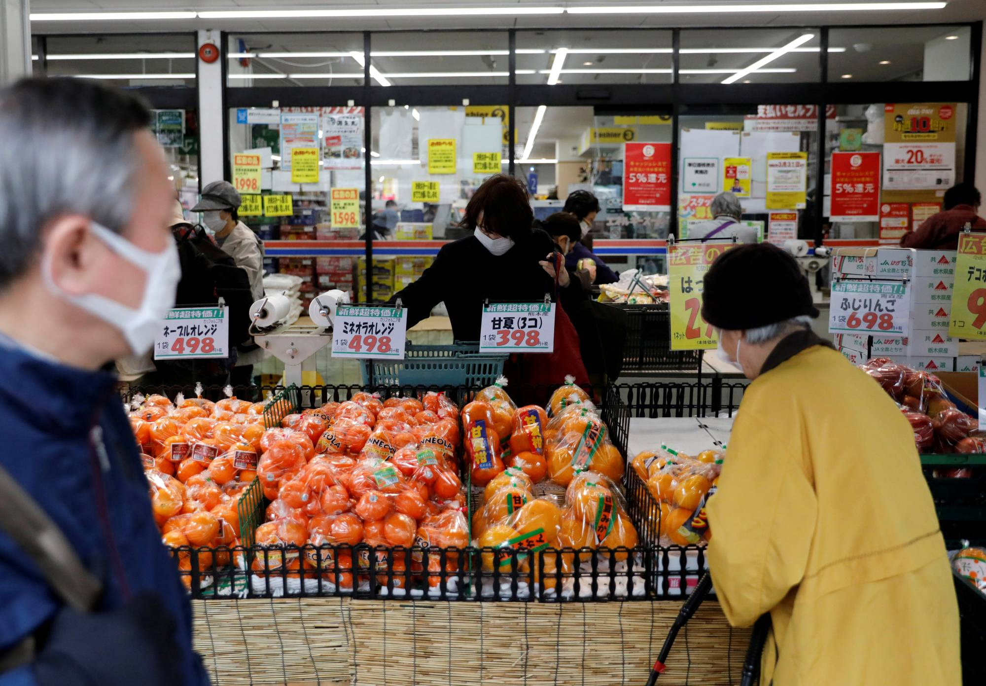 No masking the concern: Tokyoites shop while wearing masks amid the coronavirus outbreak. As the country relaxes measures to curb the spread of infection, some people are expressing their unease. | REUTERS