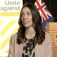 New Zealand Prime Minister Jacinda Ardern looks up as an earthquake strikes during a live television interview in Wellington on Monday morning. | NEWSHUB / VIA AP)