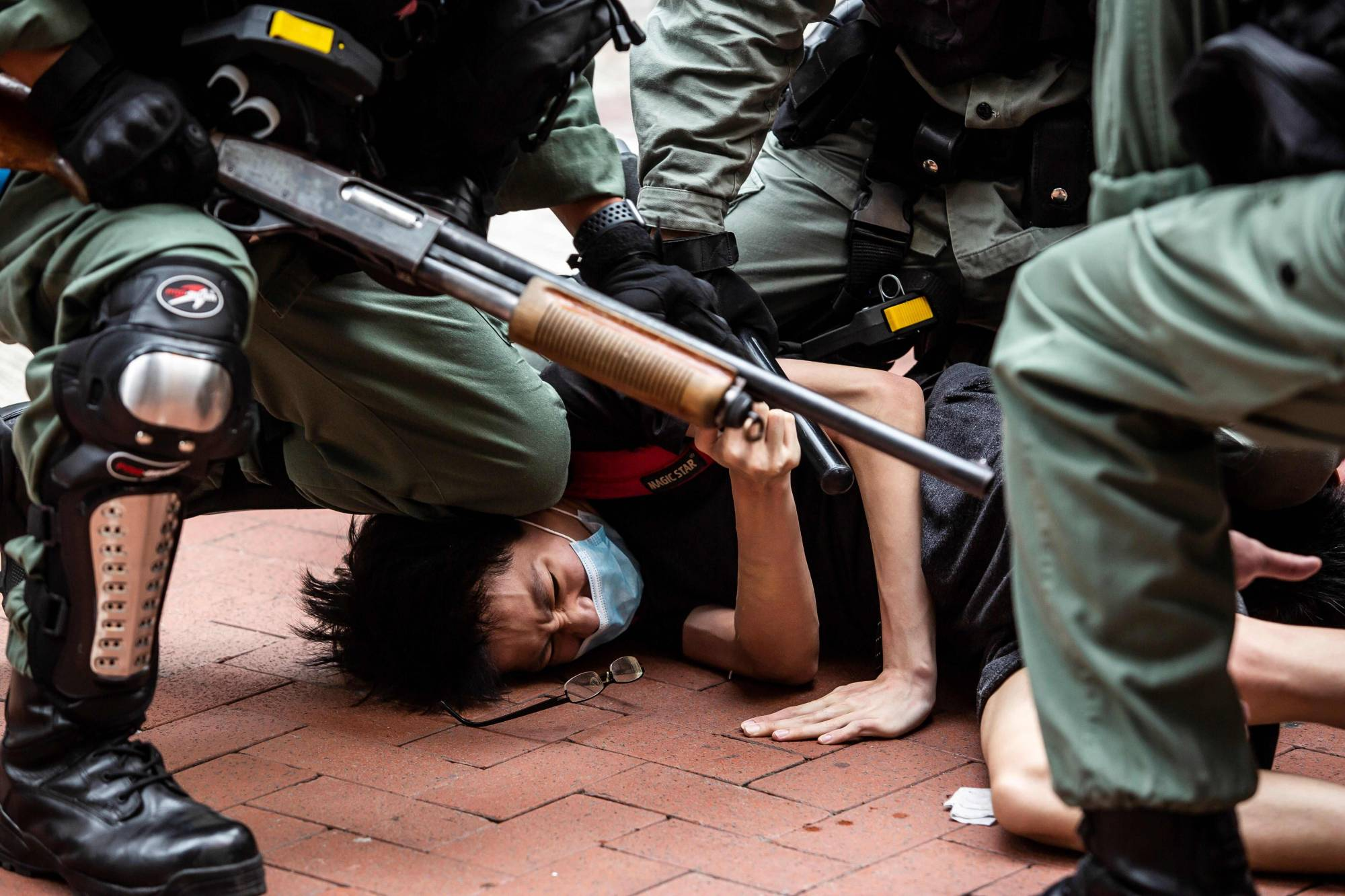 A pro-democracy protester is arrested by police in the Causeway Bay district of Hong Kong on Sunday ahead of planned protests against a proposal to enact new security legislation in Hong Kong. | AFP-JIJI