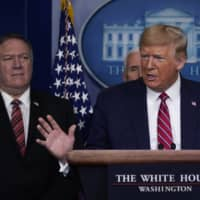 U.S. President Donald Trump speaks alongside Secretary of State Mike Pompeo during a coronavirus task force briefing at the White House.   AP