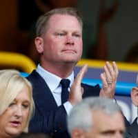 Huddersfield owner Phil Hodgkinson applauds during a game between his club and Derby County on Aug. 5 in Huddersfield, England. | REUTERS