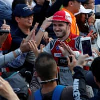 Audi Sports' Daniel Abt celebrates with fans after winning the Formula E Hong Kong ePrix on Dec. 3, 2017, in Hong Kong. | REUTERS