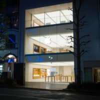 An Apple Inc. store stands closed at night in the Shibuya district of Tokyo on April 12 under the state of emergency. Apple is reopening some stores in Japan this week. | BLOOMBERG