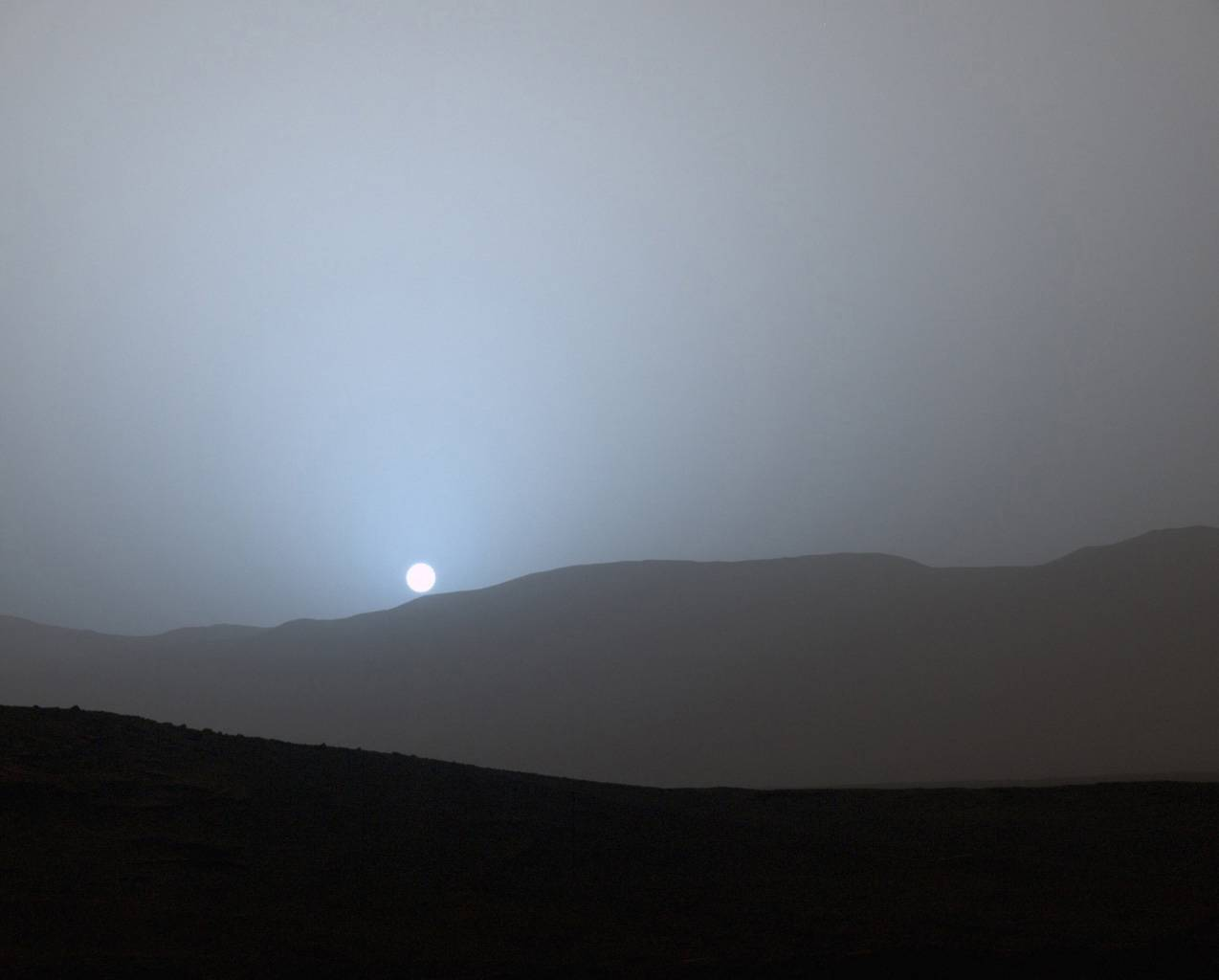 The sun sets over Mars on April 15, 2015. This summer NASA will launch a rover to collect samples of the Martian surface that will eventually be brought back to Earth. | NASA /VIA GETTY IMAGES /VIA BLOOMBERG