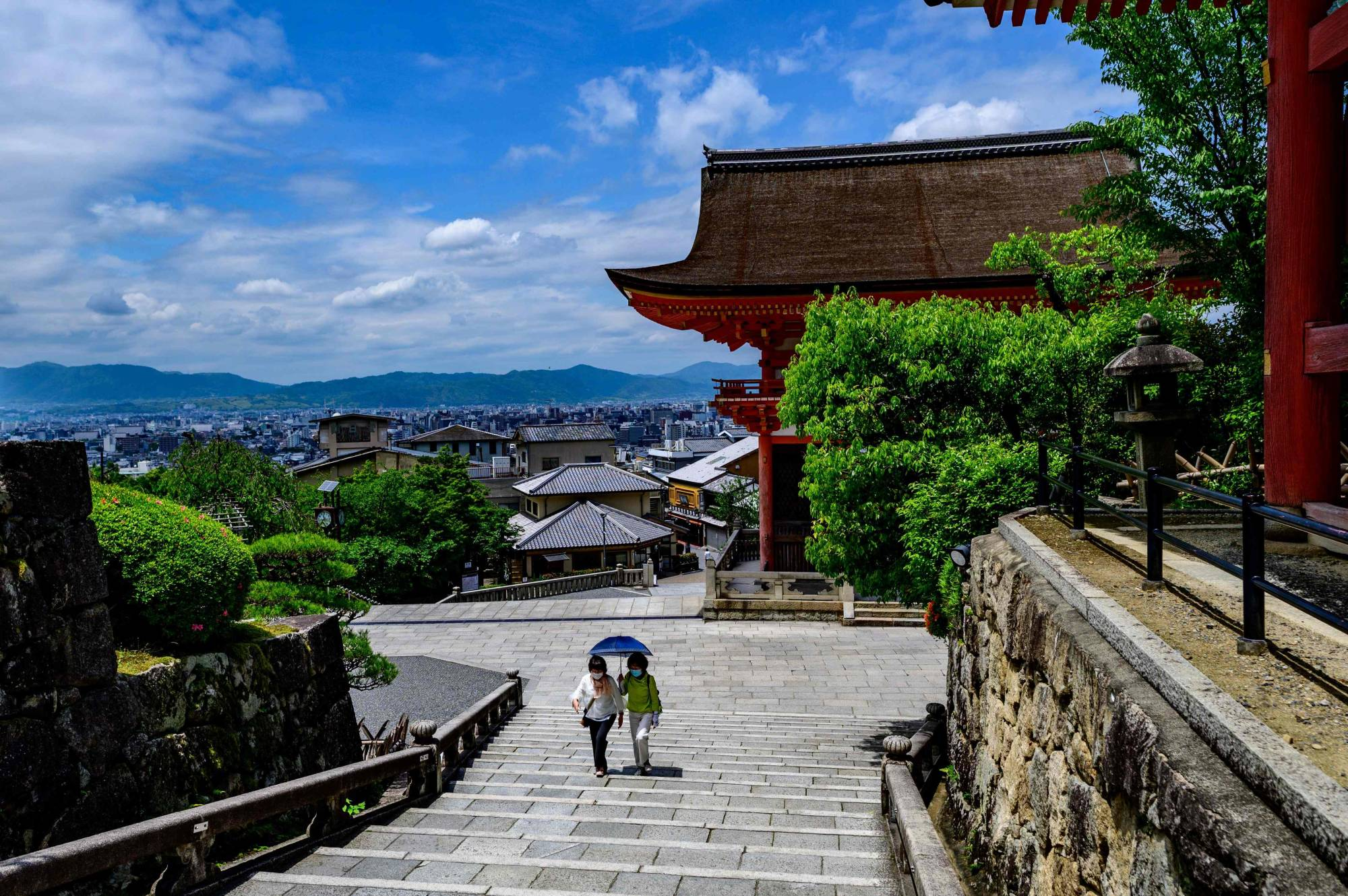 Visitors walk on the grounds of the normally busy Kiyomizu Temple, a UNESCO World Heritage structure set in the hills around Kyoto.   AFP-JIJI