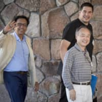 Masayoshi Son's SoftBank Group Corp. has been plagued by losses and infighting involving Vision Fund chief Rajeev Misra (left) and Chief Operating Officer Marcelo Claure, seen here at a conference in Sun Valley, Idaho, in July 2018. | BLOOMBERG