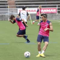 Cerezo Osaka players train on Monday at the club's training facility in Osaka. | CEREZO OSAKA / VIA KYODO