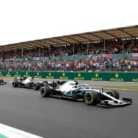 Formula One cars race in the British Grand Prix on July 14 at Silverstone Circuit in Silverstone, England. | REUTERS