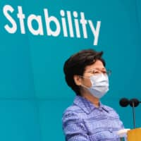 Hong Kong Chief Executive Carrie Lam speaks during a news conference on Tuesday.  | REUTERS