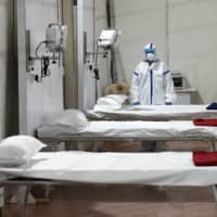 Beds are prepared at a hospital that has been constructed to treat COVID-19 patients in Mumbai, India, on Friday.  | REUTERS
