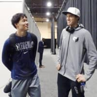 Baba (left), then playing for the Texas Legends in the G League, meets Yuta Watanabe of the Memphis Hustle after a game in Las Vegas on Dec. 19. | KYODO
