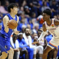Baba (left) looks to pass the ball as Oklahoma City's Shai Gilgeous-Alexander defends during an NBA preseason game in Tulsa, Oklahoma, on Oct. 8. | AP / VIA KYODO