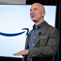 Amazon.com Inc. boss Jeff Bezos speaks at the National Press Club in Washington last September. Amazon is reportedly in talks to buy driverless vehicle startup Zoox Inc. | BLOOMBERG