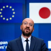 European Council President Charles Michel speaks during a news conference following an EU-Japan videoconference summit at the body's headquarters in Brussels on Tuesday. | POOL / VIA REUTERS