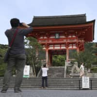 The usual crowds of tourists are absent from Kiyomizu Temple in the city of Kyoto on Saturday.