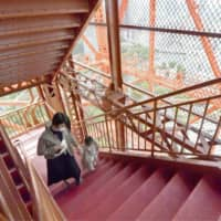 Visitors climb the stairs to the observation deck of Tokyo Tower on Thursday after it reopened following nearly two months of closure. | KYODO