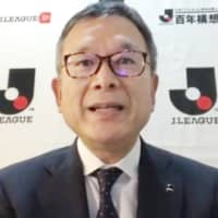 J. League Chairman Mitsuru Murai speaks during an online news conference on May 22.  | KYODO