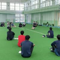 Blue Oceans players gather for practice on May 21 in Ginowan, Okinawa Prefecture | KYODO