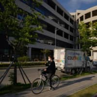 A warehouse of South Korean online delivery service Coupang in Bucheon, near Seoul, has been linked to dozens of new coronavirus cases this week.  | AFP-JIJI