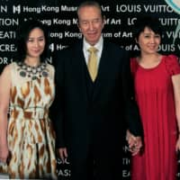 Macao tycoon Stanley Ho (center), his daughter Pansy Ho and his wife Angela Leong On Kei (right) attend a Louis Vuitton exhibition in Hong Kong in May 2009.  | REUTERS