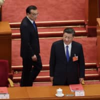 Chinese President Xi Jinping (right) and Premier Li Keqiang arrive for the the closing session of the National People's Congress at the Great Hall of the People in Beijing on Thursday. | AFP-JIJI