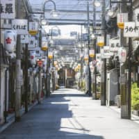 Shops at Tobita Shinchi, a major red-light district in the city of Osaka, are set to open on Monday.  | KYODO