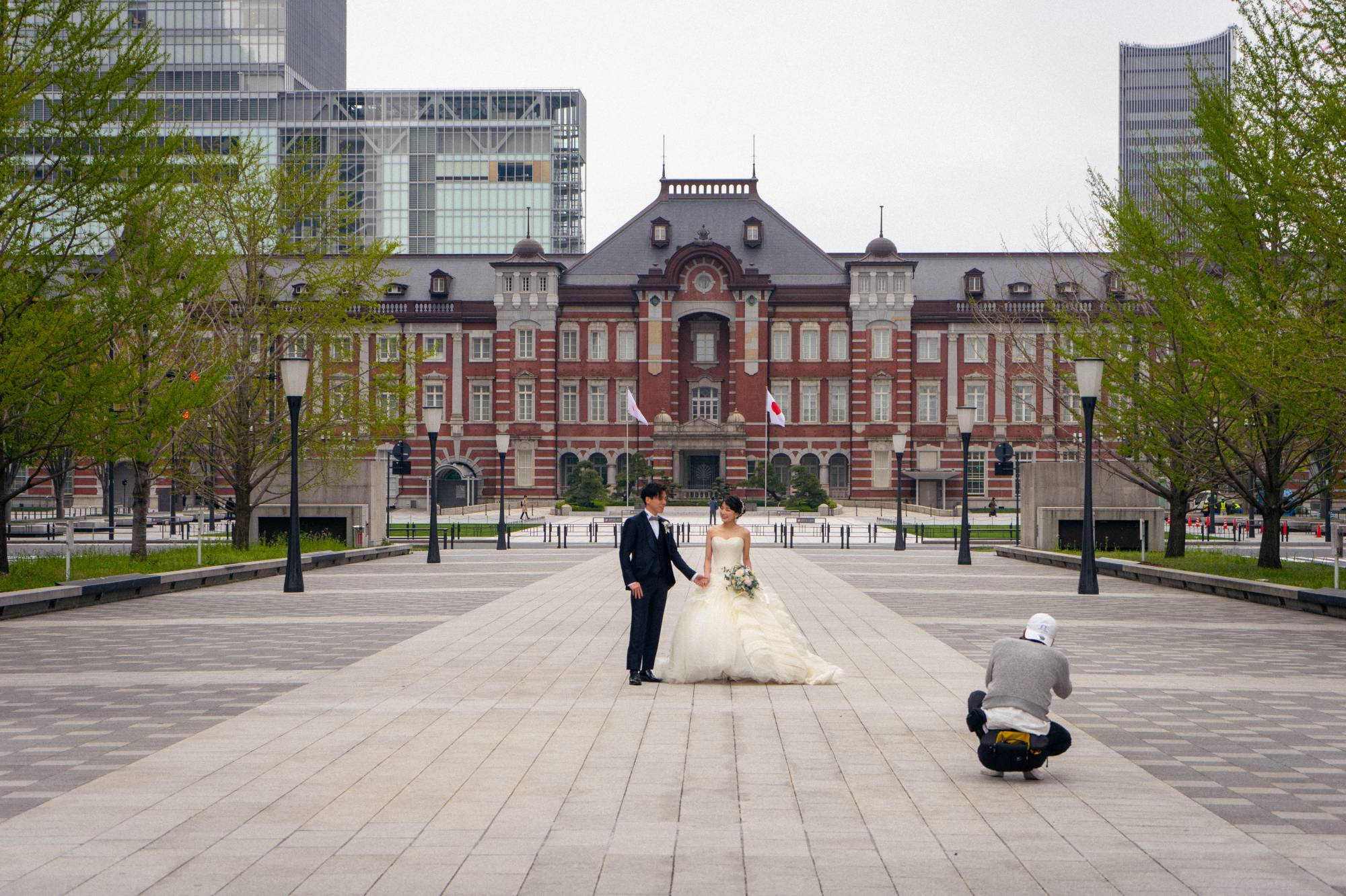 While the state of emergency forced an abrupt change to most people's lives, some saw the empty city as an opportunity. Here a couple uses an empty Tokyo Station as a backdrop for their wedding photos. On average, more than 500,000 people use Tokyo Station every day. | OSCAR BOYD