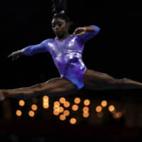 Simone Biles 'praying for the best' with rescheduled Olympics