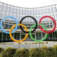 The Olympic rings are displayed outside the International Olympic Committee's headquarters in Lausanne, Switzerland, in March. | REUTERS / VIA KYODO