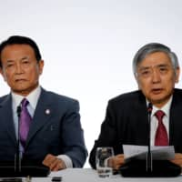 In a rare joint statement last week, BOJ Gov. Haruhiko Kuroda and Finance Minister Taro Aso pledged to work hand in glove to facilitate the nation's economic recovery. | REUTERS