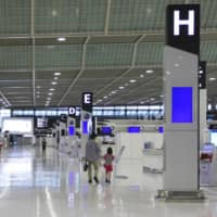 A Narita airport terminal is quiet on May 2, during the Golden Week holidays amid a state of emergency declared over the coronavirus pandemic. | KYODO